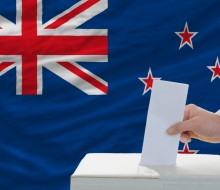 Ballot box and New Zealand flag